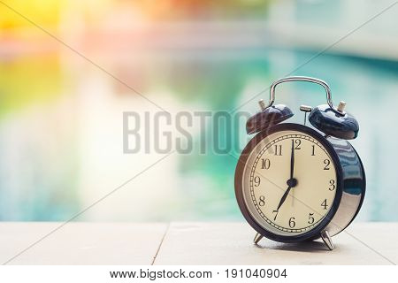 7 O'clock Retro Clock At The Swimming Pool Outdoor Holiday Time Concept.