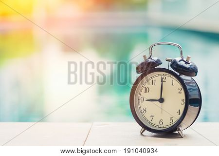 9 O'clock Retro Clock At The Swimming Pool Outdoor Holiday Time Concept.