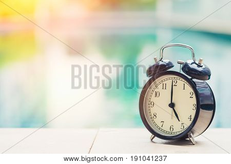 5 O'clock Retro Clock At The Swimming Pool Outdoor Holiday Time Concept.