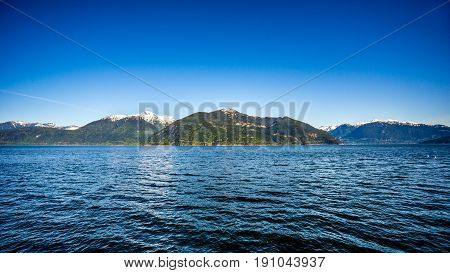 The waters of Howe Sound and surrounding mountains along Highway 99 between Vancouver and Squamish, British Columbia. Viewed from the Porteau Cove ferry docks