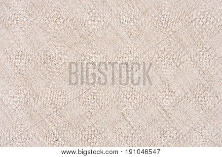 Beige canvas cotton fabric texture. Abstract background.