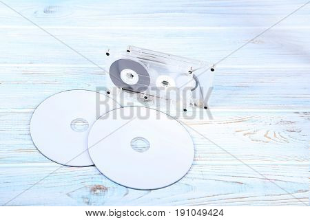 Cassette Tape With Cd Disk On White Wooden Table