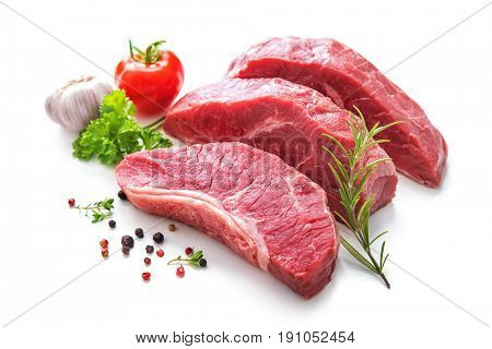 Pieces of raw roast beef meat with ingredients for grilling isolated on white