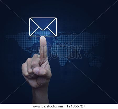Hand pressing mail flat icon over digital world map Contact us concept Elements of this image furnished by NASA