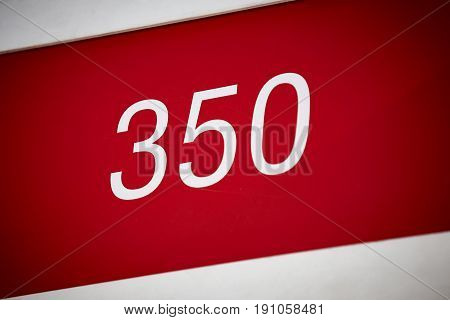 Hotel room number in red and white. Tourist apartment. Vacation