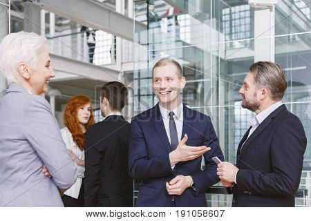 Elegant man introducing the new contractor to his boss