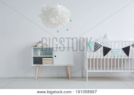 Bright and dreamy kid bedroom with white furniture