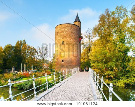 Old stone spillway tower at Minnewater lake, aka Lake of Love, in Bruges, Belgium.