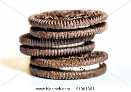 pile of brown biscuits on white background
