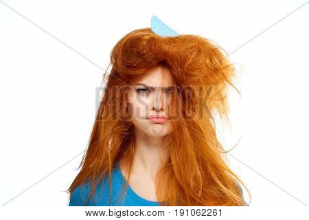 Comb in hair, woman with tangled hair on isolated background.