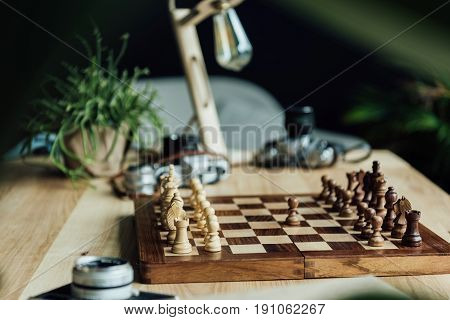 One Black Pawn Staying Against Full Set Of Chess Pieces At The Table