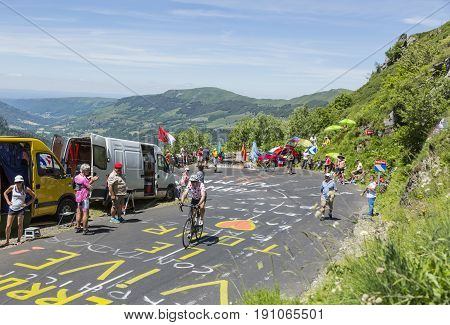 Pas de Peyrol France - July 62016: Unidentified amateur cyclist in Polka-Dot-Jersey climbing the road to Pas de Pyerol (Puy Mary) in Cantalin the Central Massif during the stage 5 of Tour de France on July 6 2016.