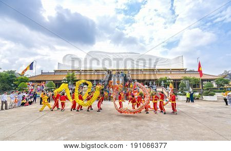 Binh Duong, Vietnam - February 5th, 2017: Festival in the old temple has beautiful architecture with the dragon dance martial arts students performed in Chinese Lantern Festival in Binh Duong, Vietnam