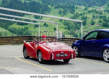 Elderly Driver In Triumph Tr3 Red Oldtimer Car