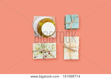 spa, bodycare and natural cosmetics concept - handmade soap bars over pink background