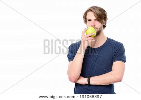 Sexy Macho In Blue Tshirt With Thoughtful Face Holds Apple