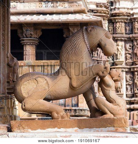 Sculpture of woman with lion at the Kandariya Mahadeva temple in Khajuraho, India. Most Khajuraho temples were built between 950 and 1050 by the Chandela dynasty.
