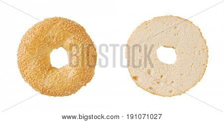 halved bagel with sesame seeds on white background