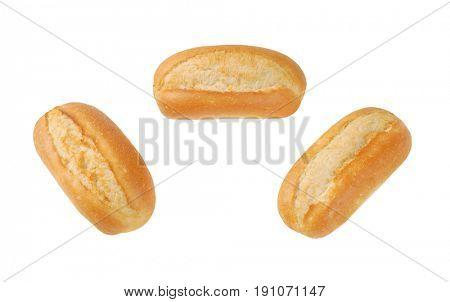 three freshly baked mini baguettes on white background