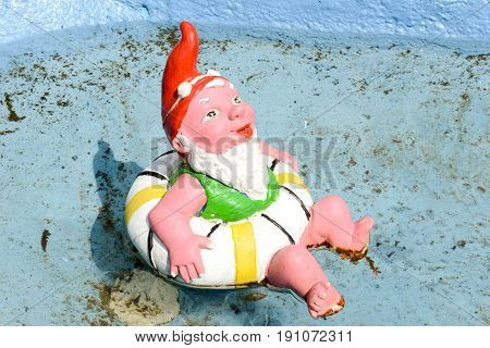 Engelberg, Switzerland - 12 August 2015: Garden gnome in a swimming pool