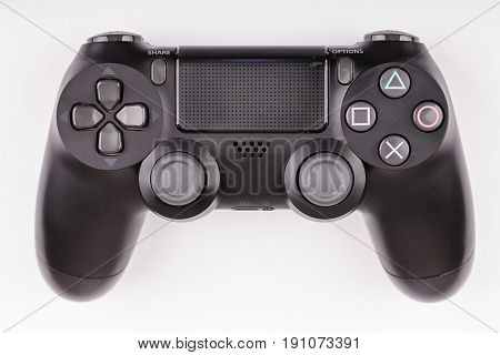 A wireless game controller on a white background