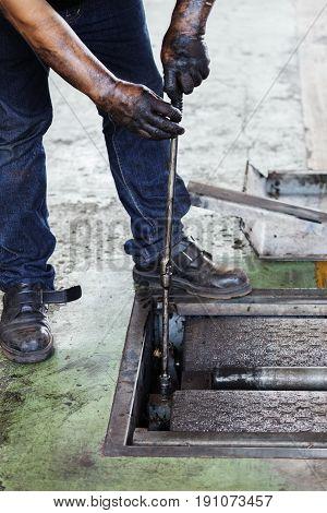Repairman During Maintenance Work Of Machine