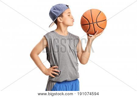 Boy kissing a basketball isolated on white background