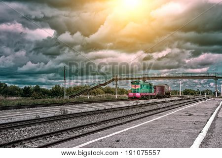 Freight train at railway station. Railroad junction.