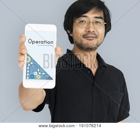 Asian man showing smart phone with operation word on hand
