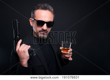 Armed Gunman With A Glass Of Alcohol