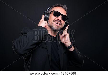 Classy Handsome Man Listening Music