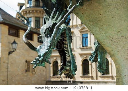 Copper sculpture of a mythical dragon, a fragment of a city fountain