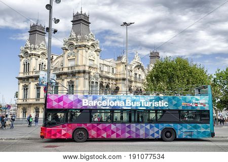BARCELONA SPAIN - APRIL 19: Sightseeing bus in street La Rambla on April 19 2017 in Barcelona