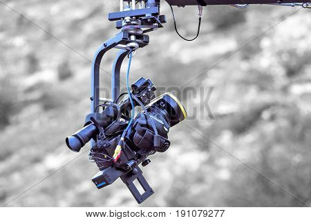 Tv camera recording on a crane, isolated on black and white background