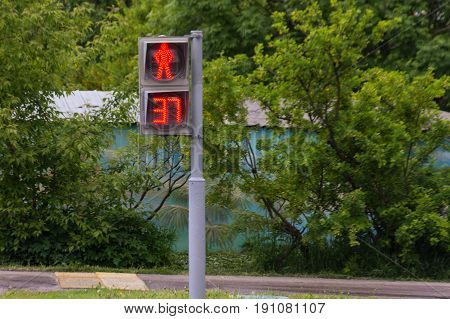 Pedestrian light traffic sign that shows red don't walk symbol and timer