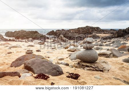 Stone pebble cairn in Cape Conran Beach, Australia