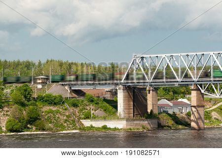 The Train Goes On The Railway Bridge Through The River