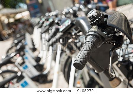 Close Up Of Bicycles On Parking In Madrid. Close Up Of Bicycle handlebars.