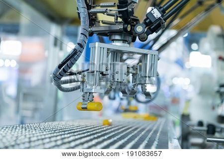 Industrial robot with conveyor in manufacture factory,Smart factory industry 4.0 concept.