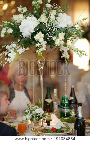 White crystal chains hang from the gorgeous white bouquet