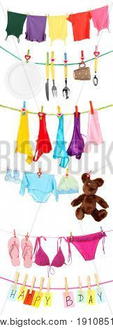 Different stuff hanging from clotheslines on white background