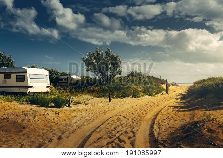 Camping Trailer On Sandy Beach of The Sea Summer Holidays Road Trip Vacation Travel Concept
