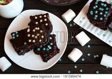 Cookies With Marshmallows In Chocolate Glaze And Decorative Asterisks