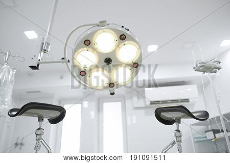Point of view shot from a gynecological chair in operating theatre at the hospital pregnancy gynecology medicine healthcare profession vitality clinical concept.