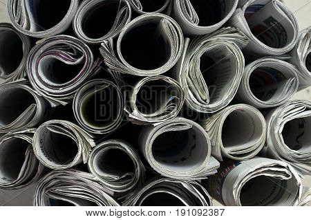 Close up shot of rolled newspapers texture
