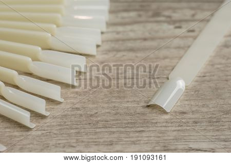 Macro shot of a lot of white artificial nails