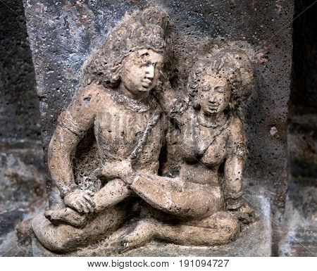 Stone figure of lovers in Ajanta caves, India. The Ajanta Caves in Maharashtra state are about 30 rock-cut Buddhist cave monuments, which date from the 2nd century BCE to about 480 or 650 CE