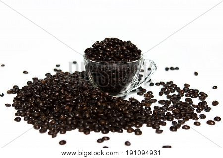Coffee beans in a cup of coffee isolated on white background.