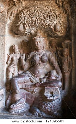 Durga Goddess with lion - ancient bas-relief in Ellora caves, India. Ellora is one of the largest rock-cut temple caves complexes in the world and a UNESCO World Heritage Site in Maharashtra state.