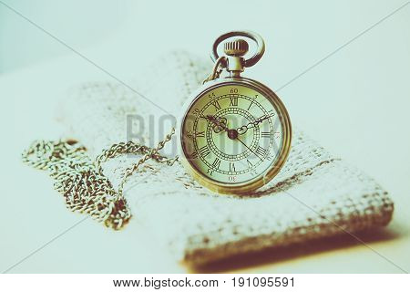 The old pocket watch in a lonely atmosphere.